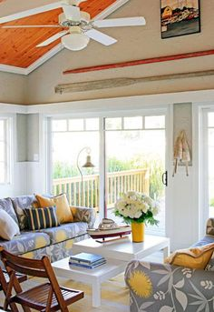 A tiny riverfront home in southwestern Michigan recaptures its original cottage character with paint, fabric and a floor plan overhaul.