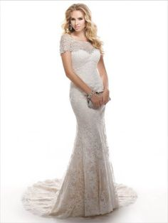 Maggie Sottero - CHESNEY, Strapless lace gown in a classic silhouette with dramatic flair.  Finished with zipper over inner corset with crystal button closure.