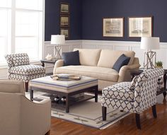 5 Ways to Use Slipper Chairs  Note color of couch with the light carpet and blue tones.