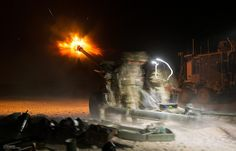 Soldiers fire illumination rounds from a L118 105mm light artlillery gun from Patrol Base Sterga in Afghanistan, for the last time before it was air lifted out and removed from theatre.