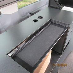 Close up of the adjustable keyboard shelf on a custom Mobile Office for the 2015 Ford Transit.  This Mobile Office gives you the same ergonomic comfort as a traditional office!