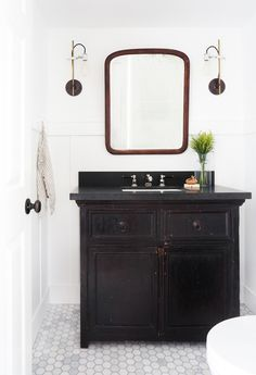 If you love a quiet, humble, unfussy interior that's incredibly welcoming, Modern Traditional style might be just what your home needs. Bad Inspiration, Bathroom Inspiration, Bathroom Ideas, Bathroom Wall, Mirror Inspiration, Bathroom Shop, Downstairs Bathroom, Bathroom Vanities, Modern Traditional