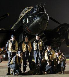 Lancaster night bomber crew prepares for action