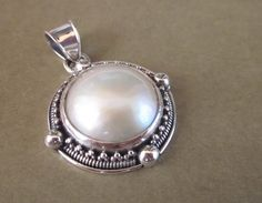 Balinese sterling Silver Pendant / White Mabe Pearl / silver 925 / Bali granulation art jewelry by Telur on Etsy https://www.etsy.com/listing/83471772/balinese-sterling-silver-pendant-white