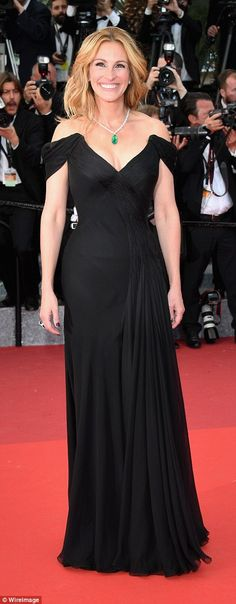 Barefoot beauty: Julia Roberts oozed sophistication in a classic black dress as she arrive...