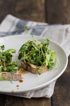 Pea Shoot and Asparagus Crostini with Hummus   @naturallyella