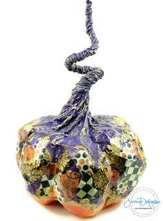 Purple and Orange patchwork paper mache pumpkin by sculpture artist Jessica Dvergsten.