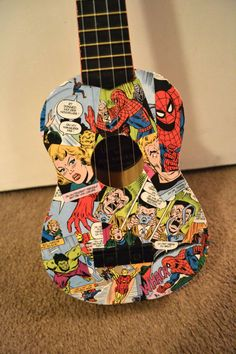 Marvel Comics Decoupage Ukulele- I'm halfway through making a ukulele. It was going to be newspaper styled but this has made me change my mind!!