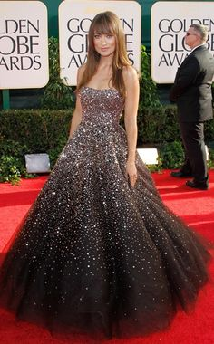 """Olivia Wilde in a deep chocolate ombre, """"star dust"""" ball gown by Marchesa & gold spiked Louboutin booties 