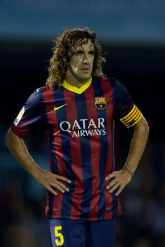 Carles Puyol of FC Barcelona looks on during the La Liga match between RC Celta de Vigo and FC Barcelona at Estadio Balaidos on October 29, 2013 in Vigo, Spain.