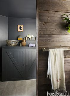 The washer and dryer are tucked into cupboards painted in Benjamin Moore's Black Latex Chalkboard paint.