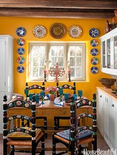 "Love the colors and the fab Mexican collections in this ""Kitchen of the Month, September 2012. Design: Judith Espinar, Jim Deville, and Scott Robey. Photo: Peter Vitale. housebeautiful.com. kitchen santa_fe southwestern dining_area pottery"""