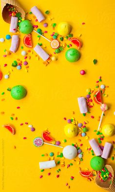 Different kind of colorful candies in ice cream cone on yellow background by Marko Milanovic for Stocksy United Food Wallpaper, Colorful Wallpaper, Nature Wallpaper, Mobile Wallpaper, Candy Background, Yellow Background, Ice Cream Background, Yellow Candy, Colorful Candy