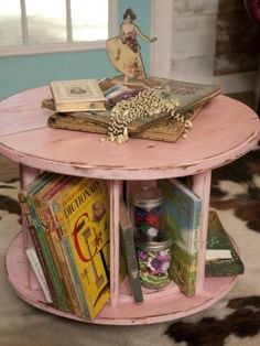 industrial wire spindle into a combination coffee table and book rack....DAD has the spools already!