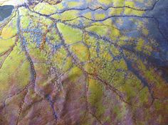6 tips for better machine needle felting. Barbara Schneider uses needle felting to create the mottled texture on this fabric leaf.