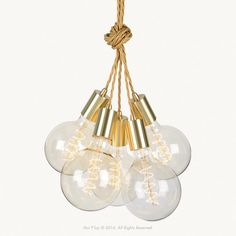 Our Gold Cluster Pendants are made from solid brass, with twisted gold fabric electrical cable cord. The cluster of five pendants can be hung straight down along side each other, draped from the ceiling using a Electrical Cable, House Lighting, Gold Fabric, Perth, Solid Brass, Bulbs, Cord, Family Room, Pendants