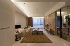 整體空間拋光石英磚為底,在書房隔間或是桌腳,可以看見黑色鐵件的跳色呈現。