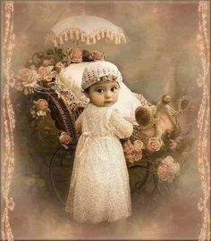 Vintage baby with baby carriage