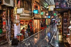 Melbourne is famous for its lanes and arcades. Degraves street is a showcase of what real Melbourne ambience is all about. Great place to have a coffee and enjoy street art show Melbourne Trip, Melbourne Laneways, Places In Melbourne, Melbourne Street, Melbourne Cbd, Melbourne Victoria, Victoria Australia, Melbourne Australia, Melbourne Weather