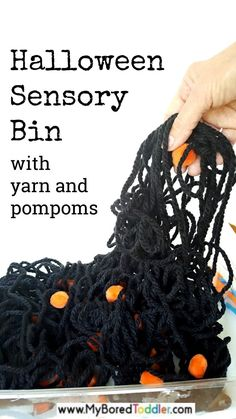 Halloween Sensory Bin with Yarn and Pompoms