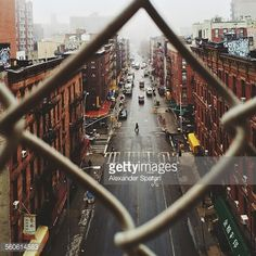 Stock Photo : Chinatown seen through fence on a foggy day, NYC