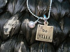 be still necklace - bronze charm the size of a pea with a tiny pearl - $23