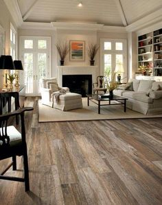 Beautiful living room with wood flooring and light accents