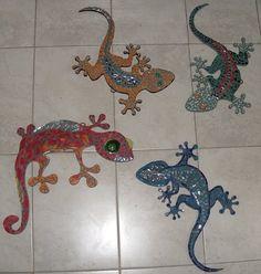 Iguanas en mosaicos gemas y espejos