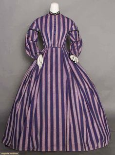 "PURPLE STRIPE DAY DRESS, 1860s, light weight wool woven in alternating dark & light stripes with orange pin stripes, jet buttons and trim; cap sleeves with jet tassels, bodice lined with brown cotton; bust: 35""; waist: 27""; length: 54-59"""