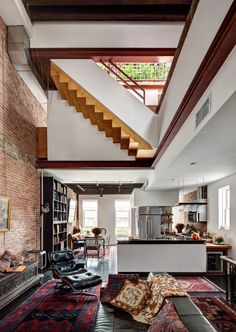 The owner of this old railroad-style Brooklyn home opened up the living area by demolishing interior walls to provide a 20-ft high ceiling while maintaining the original brick features. [[727 × 1024] - Imgur