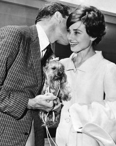 Audrey Hepburn and husband Mel Ferrer photographed with their Yorkshire terrier, Mr. Famous, July 2, 1958.