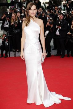 Hilary Swank at the Homesman Premier during the 2014 Cannes Film Festival I Wearing a Atelier Versace gown with sapphire Chopard jewellery.