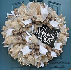 This is a very large, very full wreath, measuring approximately 28 inches, with a depth of 9 inches. Made with 3 layers of burlap And mesh, an assortment of gorgeous, high quality ribbons, beautiful pearl picks and a handmade - Customizable - vintage chalkboard sign that states Welcome to our Home  Chalkboard Sign -  This sign is customizable! And the possibilities are endless! Anything from Monogrammed Initials to a personalized wedding gift. Love a different phrase Or prefer it be left…