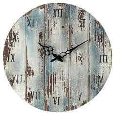 "Weathered wood wall clock.   Product: Wall clockConstruction Material: WoodColor: Dark blueAccommodates: (1) AA Battery - not includedDimensions: 1.25"" H x 16"" Diameter"