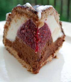 raspberry heart in a body of chocolate cake