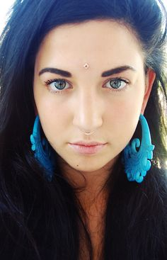 Septum, forehead, and stretched ears. Beautiful.