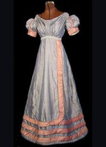 1820 - 1825 blue silk gown with Rouleau trim - Courtesy of antiquedress .com