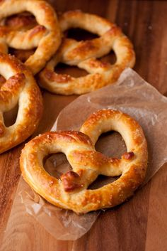 Pretzel Recipe --  2 cups milk (I used 2%) -- 1 1/2 Tbsp active dry yeast (2 packets) -- 6 Tbsp packed light-brown sugar -- 4 Tbsp butter, at room temperature -- 4 1/2 cups all-purpose flour, plus an up to an --additional 1/2 cup as needed -- 2 tsp fine salt -- 1/3 cup baking soda -- 2 cups warm water -- coarse salt, to taste -- 6 Tbsp butter, melted -- Dipping sauce for serving, optional* Pretzel Bun Recipe, Pretzel Dough, Pretzels Recipe, Homemade Soft Pretzels, Fruit Recipes, Cake Recipes, Vegan Recipes, Cooking Recipes, Healthy Recepies