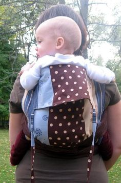 Mei Tai, the best carrier ever! You can easily make it yourself for a fraction of the cost of one in the stores and you will be able to carry your child at least until (s)he is 3 with practically no strain on your back! We (my husband and me) wouldn't have survived without one! ♥