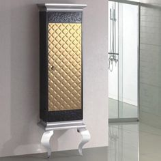 """This beautifully designed luxury cabinet is the perfect place to store your bathroom essentials. Standing tall and slender, this one of a kind sleek cabinet sits on two elegant stainless steel """"S"""" shaped legs. The artistic detail in texture and contrast of colors is sure to give your bathroom contemporary style. Contemporary Bathrooms, Contemporary Style, Modern, Luxury Bathroom Vanities, Bathroom Essentials, Perfect Place, Contrast, Wall Lights, Vanity"""