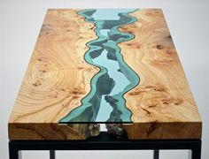 The River Collection : Designer Greg Klassen makes fabulous furniture out of the most unlikely pieces of hardwood. He inserts beautiful hand-cut glass panels like this into knots and splits in to the wood, to breathtaking effect. Of course, each pice will be utterly unique. You can see more of his creations at : www.homeli.co.uk