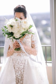 real wedding photo at four seasons los angeles at beverly hills planned by international event company bride in illusion dress with overskirt sniffing bouquet Wedding Gowns, Bridal Gowns, Wedding Flowers, Bouquet Flowers, Wedding Colors, Wedding Bouquets, Peek A Boo, Cheap Country Wedding, Country Wedding Dresses