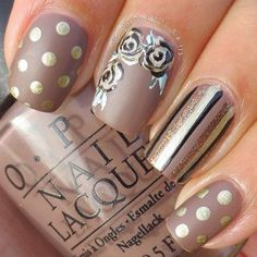 A very vintage looking nail art in sepia background with gold and black polish details depicting polka dots, bold lines and flowers.