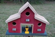 Birdhouses make excellent gifts as they are truly a gift that keeps on giving. Offered for sale is this Barn style birdhouse MADE IN USA from scrap cedar left over from a fence job. Its barn red with a tan roof.  The tractor bay has multiple uses. I use it for a feeding station and at the beginning of nesting season, I place nesting materials in the bay. This works great and your birds will sing you a song of Thanks for either treats or nesting fluff.  It will stand up to Ma Nature as it is…