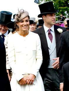 HERE COMES THE BRIDE...  ...all dressed in white! Kate Middleton and Prince William make their first public appearance as newlyweds at the prestigious Epsom Derby in Surrey, England, on June 4. The Duchess of Cambridge's sleek suit was reminiscent of another princess's chic style – Princess Diana wore a similar suit to the Ascot races in 1986.