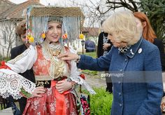 Camilla, Duchess of Cornwall meets a girl in local traditional costume, at the Bee Museum outside Novi Sad on a visit to Serbia on March 17, 2016 in Novi Sad, Serbia. The Prince of Wales and Duchess of Cornwall are currently on a 6 day tour of the Balkans.