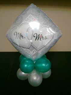 Looking for unique centerpieces for your wedding? How about balloon centerpieces like this one?