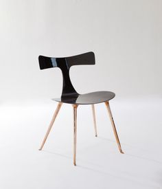 ICARUS DINING CHAIR BY RALPH PUCCI | Modern dining chair with carbon fiber seat and bronze legs.| http://bocadolobo.com/blog/  #limitededition