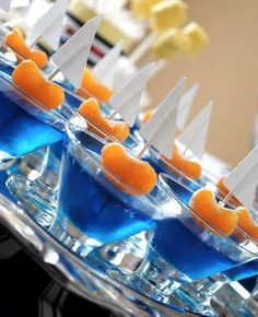 Fruit Boats: Blue jello, orange slices, and little paper sails. I think I'd use fruit roll-up sails instead of paper.