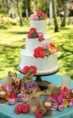 Say aloha to this week's Wedding Cake Wednesday – a buttercream delight adorned with colorful roses and succulents #cake #roses